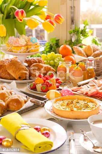 1131445181 istock photo Table with delicatessen ready for Easter brunch 918452414