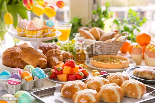 1131445181 istock photo Table with delicatessen ready for Easter brunch 918454964