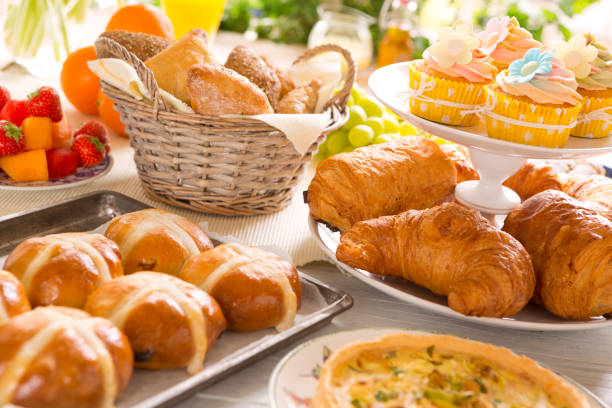 table with delicatessen ready for easter brunch - savory food stock photos and pictures