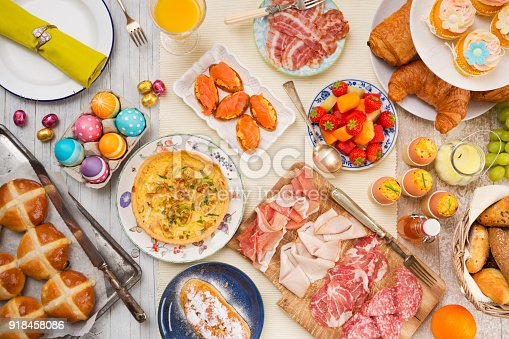 1131445181 istock photo Table with delicatessen ready for Easter brunch 918458086