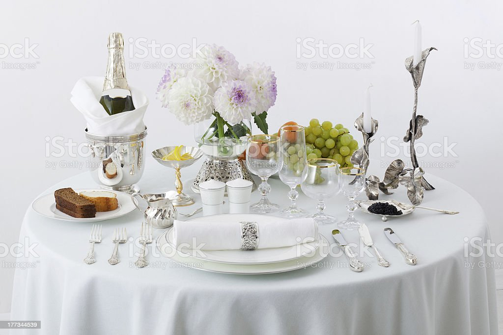 table with dishes and flowers stock photo