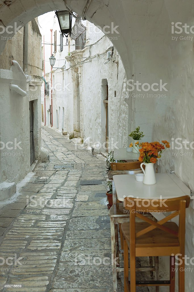 Table with Flowers at Puglia, Italy stock photo