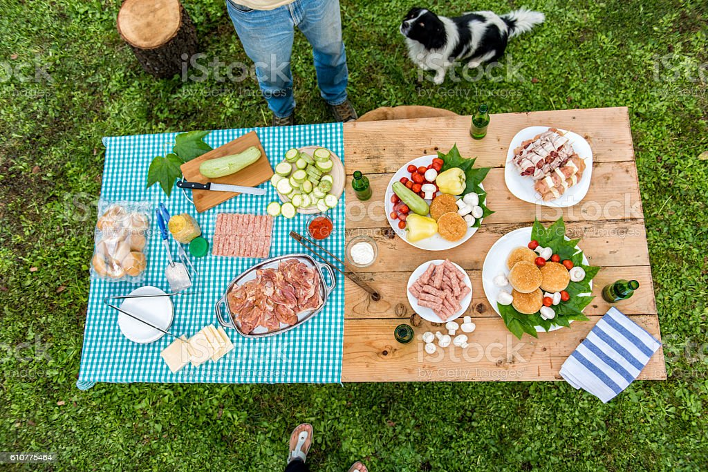 Table with food and drink ready for barbecue party stock photo