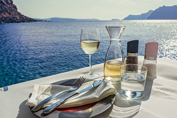 Table with food and wine on  the sea - foto stock