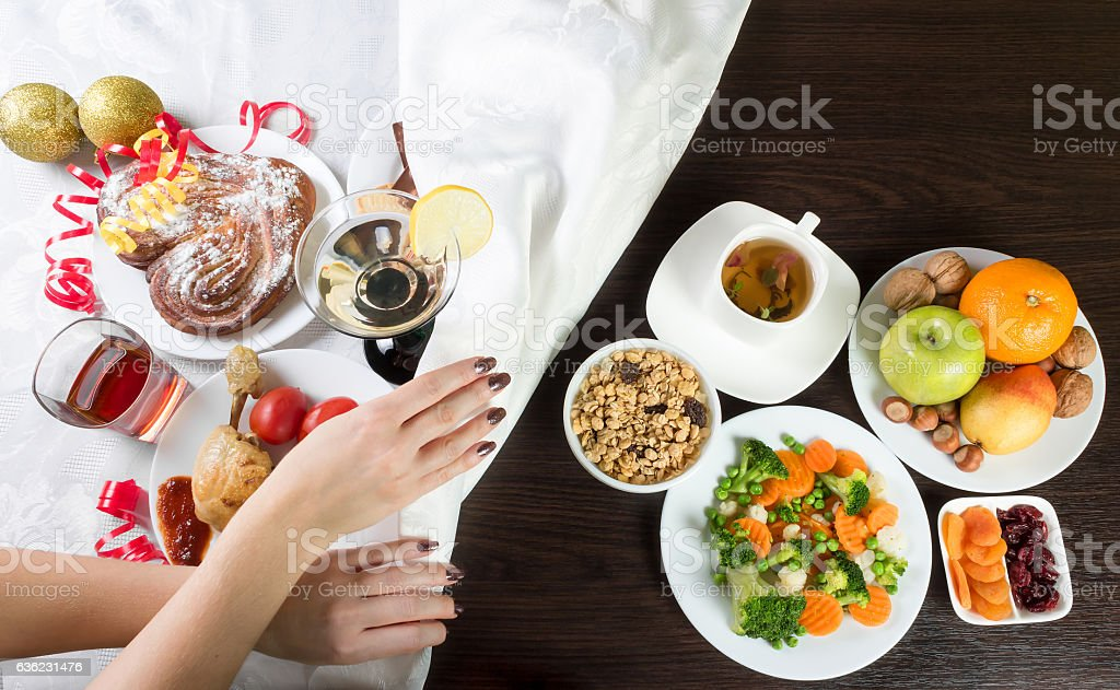 Table with healthy and unhealthy food and alcohol. stock photo