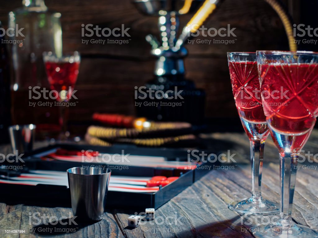 Table with hookah, backgammon and wine stock photo