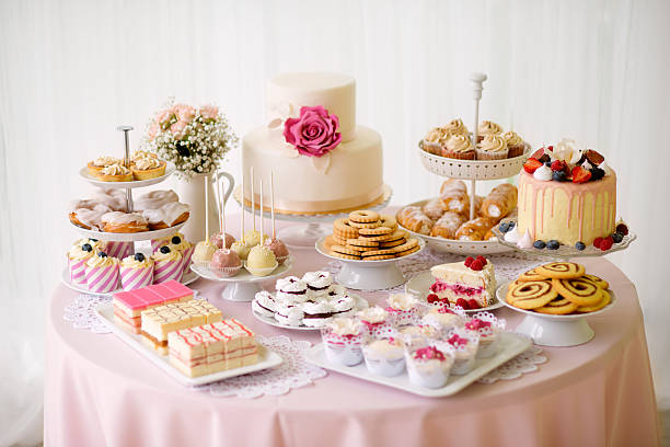table with loads of cakes, cupcakes, cookies and cakepops. - spitzenkekse stock-fotos und bilder