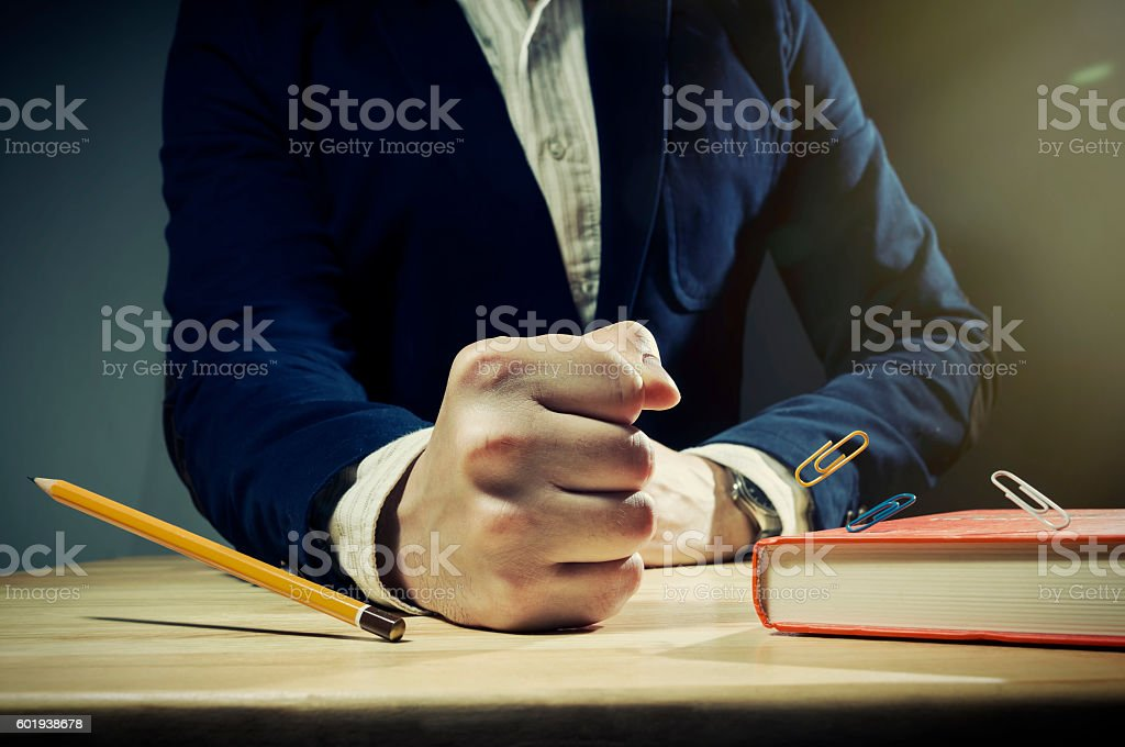 Table with mans fist. stock photo
