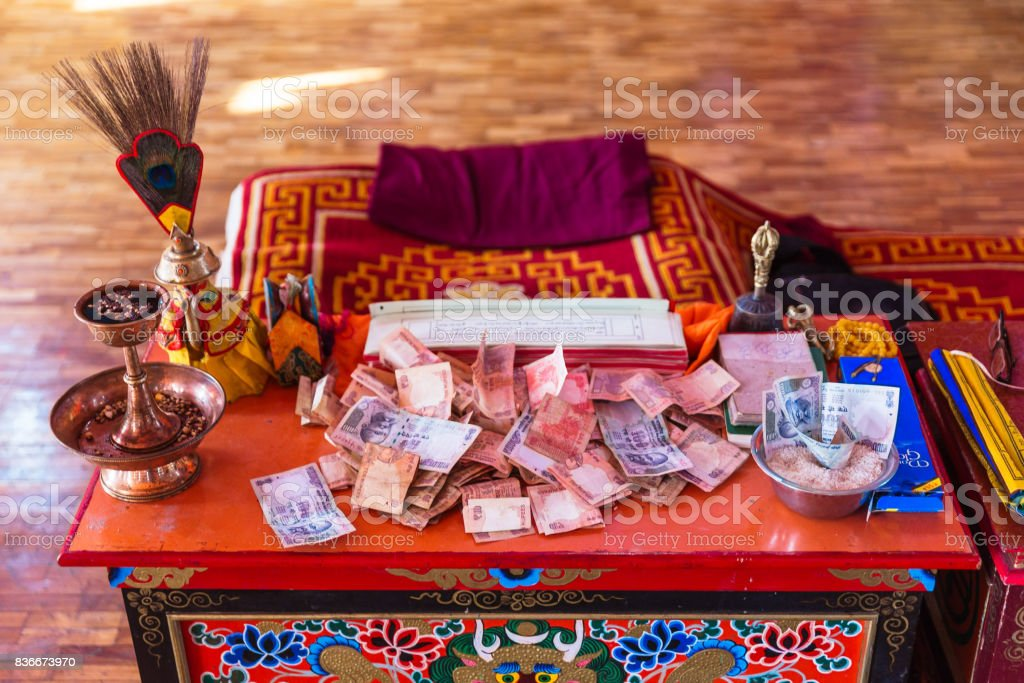 Table with money for making merit Inside Guru Rinpoche Temple at Namchi. Sikkim, India. stock photo
