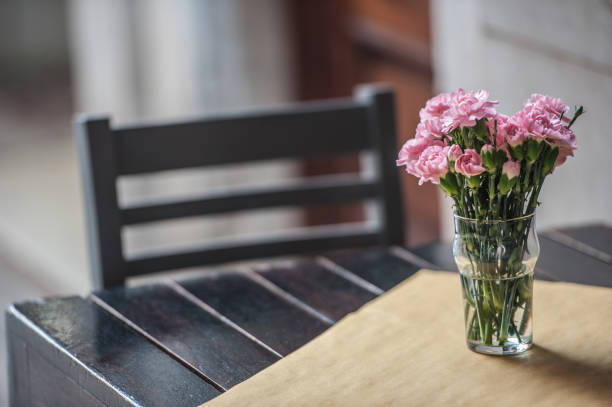 Table with Pink Carnation at the Sidewalk Cafe in Venice, Italy stock photo