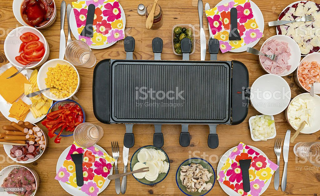 Table with raclette stock photo