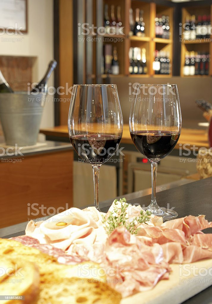A table with red wine and Italian food stock photo