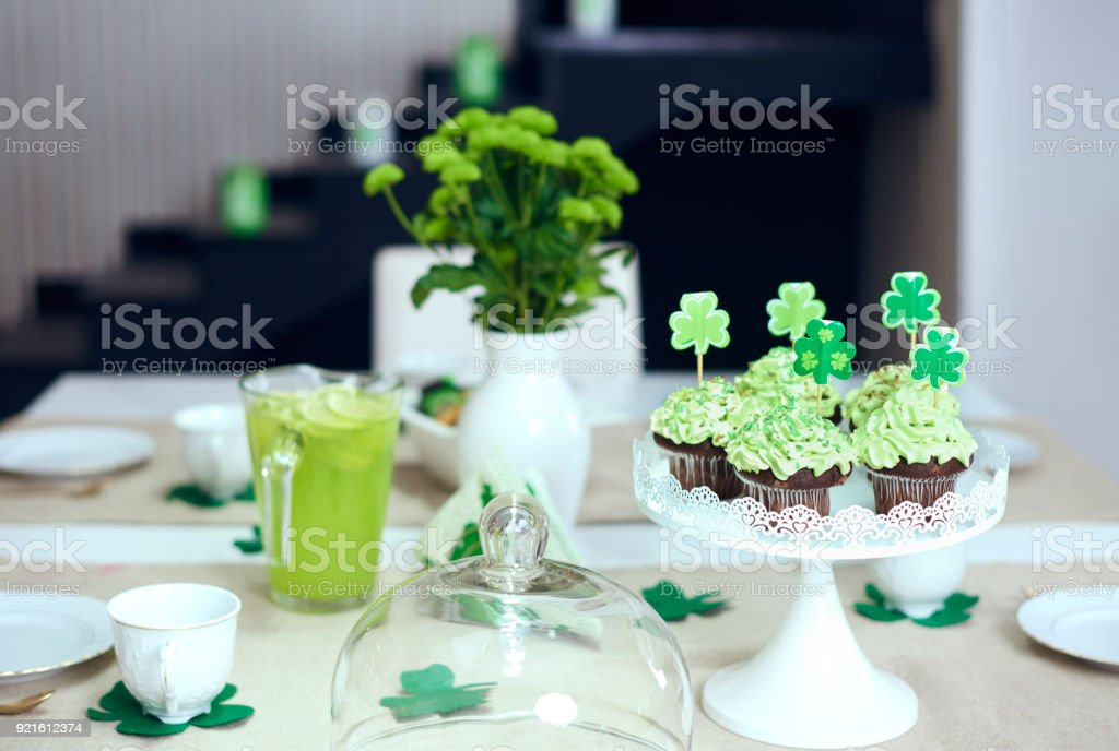 Table with sweet food at Saint Patrick's Day stock photo