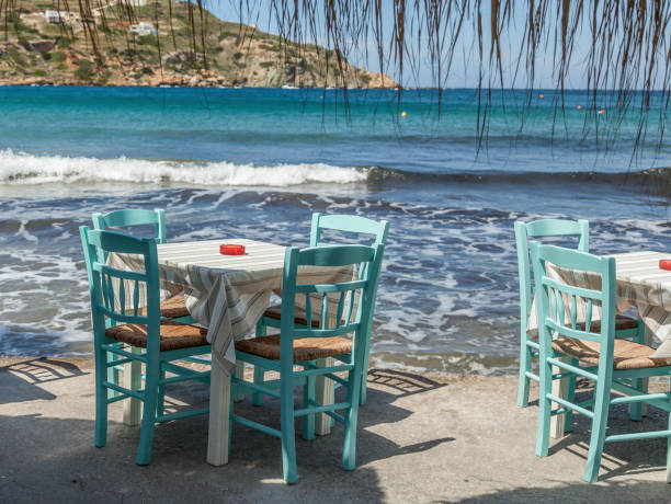Table With Turquoise Chairs. Travel Destinations stock photo