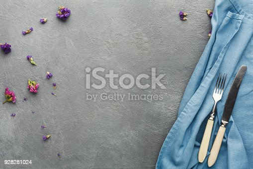istock Tablecloth and cutlery on gray table background 928281024