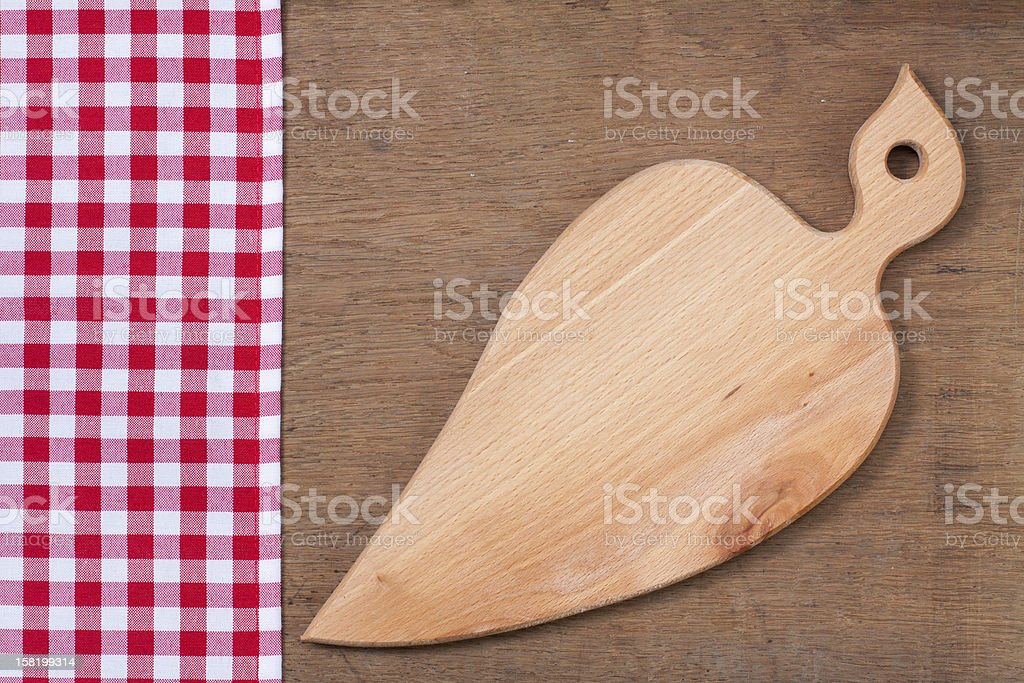 Tablecloth, kitchen plank on wooden oak table background royalty-free stock photo