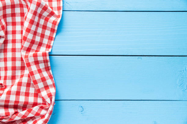 tablecloth over colorful wooden table. top view. - picnic foto e immagini stock