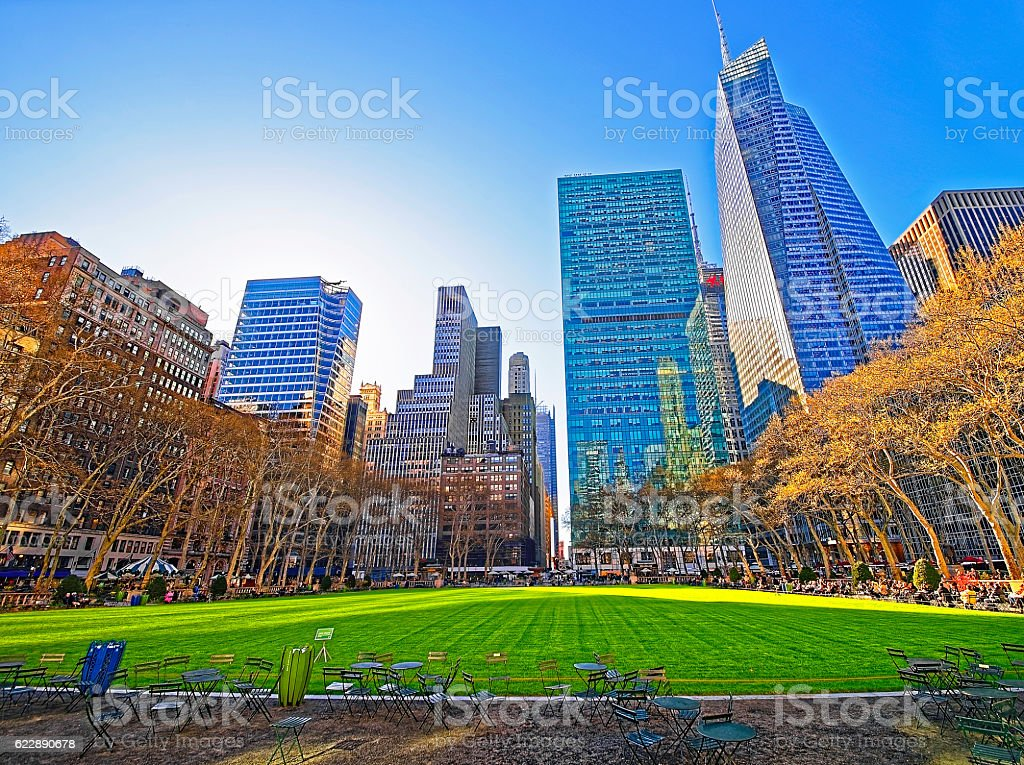 Tables and chairs and Skyscrapers viewed from Bryant Park stock photo