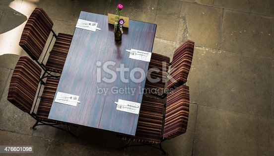 istock Tables and chairs in pub in London, UK. 476601098