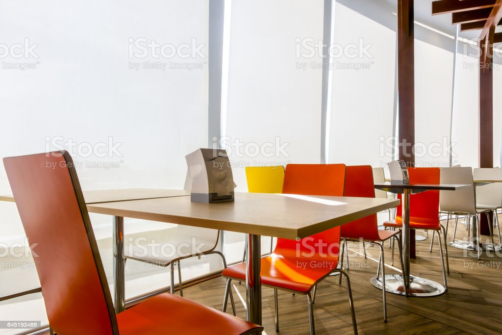 Tables and chairs in restaurant stock photo