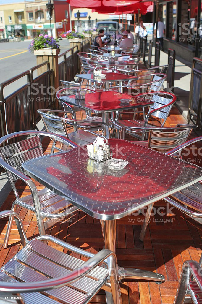 Tables and Chairs on a Street Bistro Terrace stock photo