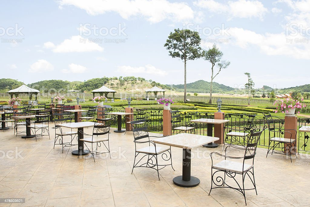 tables and chairs on terrace royalty-free stock photo