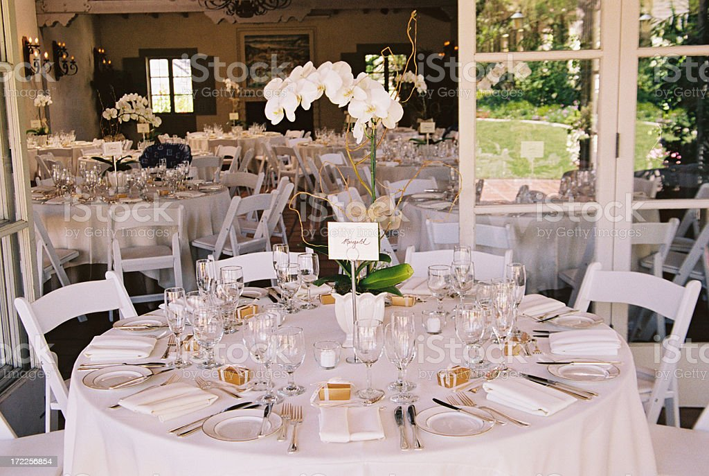 Tables decorated at stylish wedding reception royalty-free stock photo