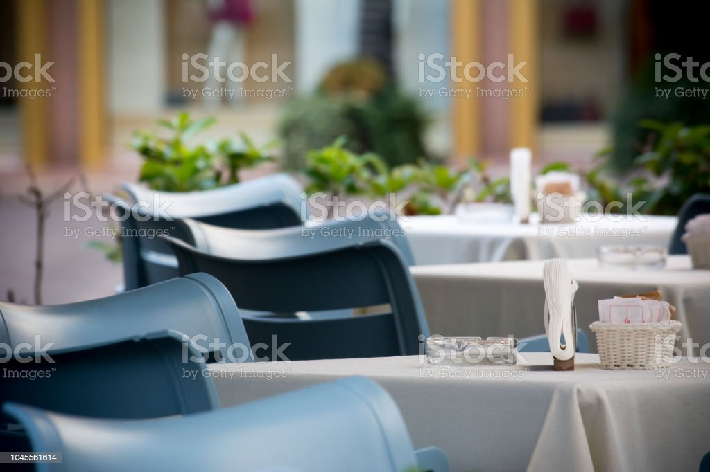 Tables in front of an Italian Bar on Blur Backgorund. Taranto, South of Italy stock photo