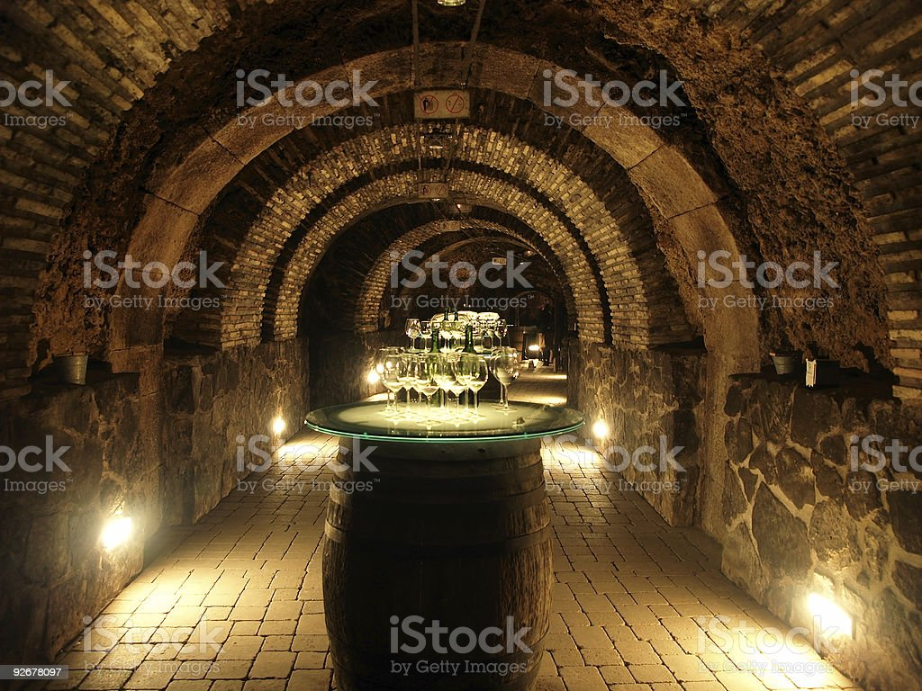 Tables made of wine barrels in a stone cellar of a winery royalty-free stock photo