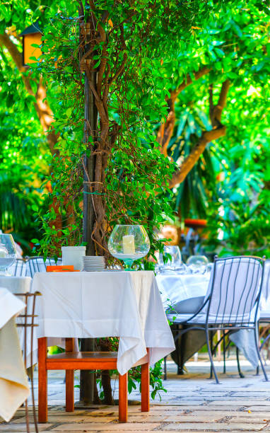 Tables of Street terraced cafe of Positano town reflex stock photo