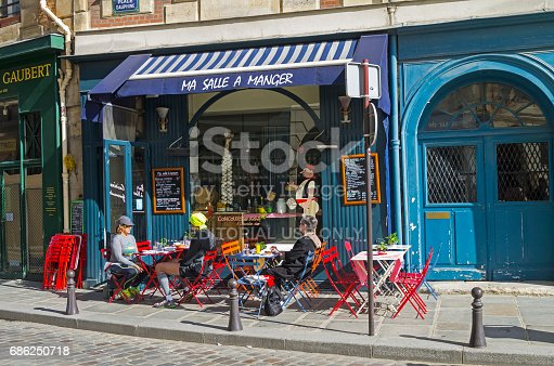 Tables On The Sidewalk In Front Of A Small Cafe Paris France Stock