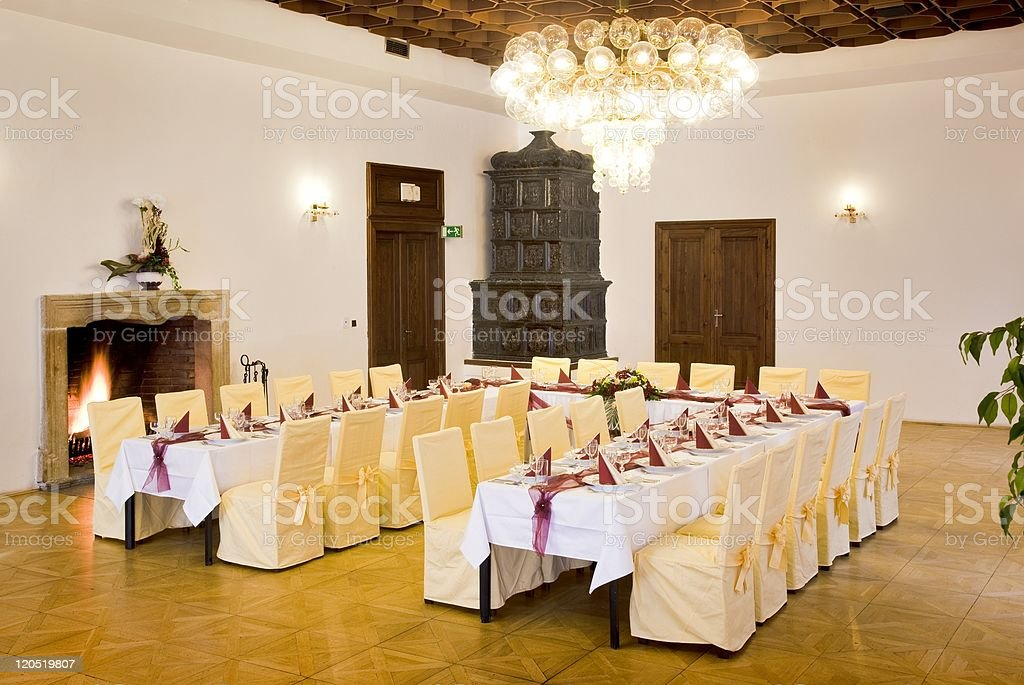 Tables set for a festive dinner royalty-free stock photo