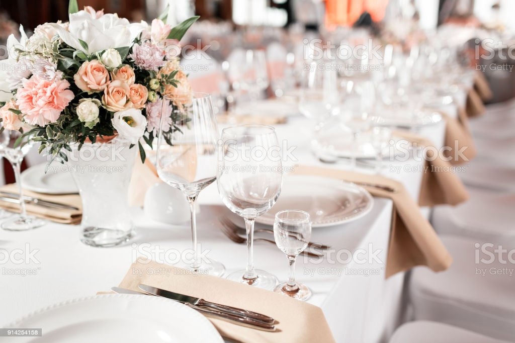 Tables set for an event party or wedding reception. luxury elegant table setting dinner in a restaurant. glasses and dishes. stock photo