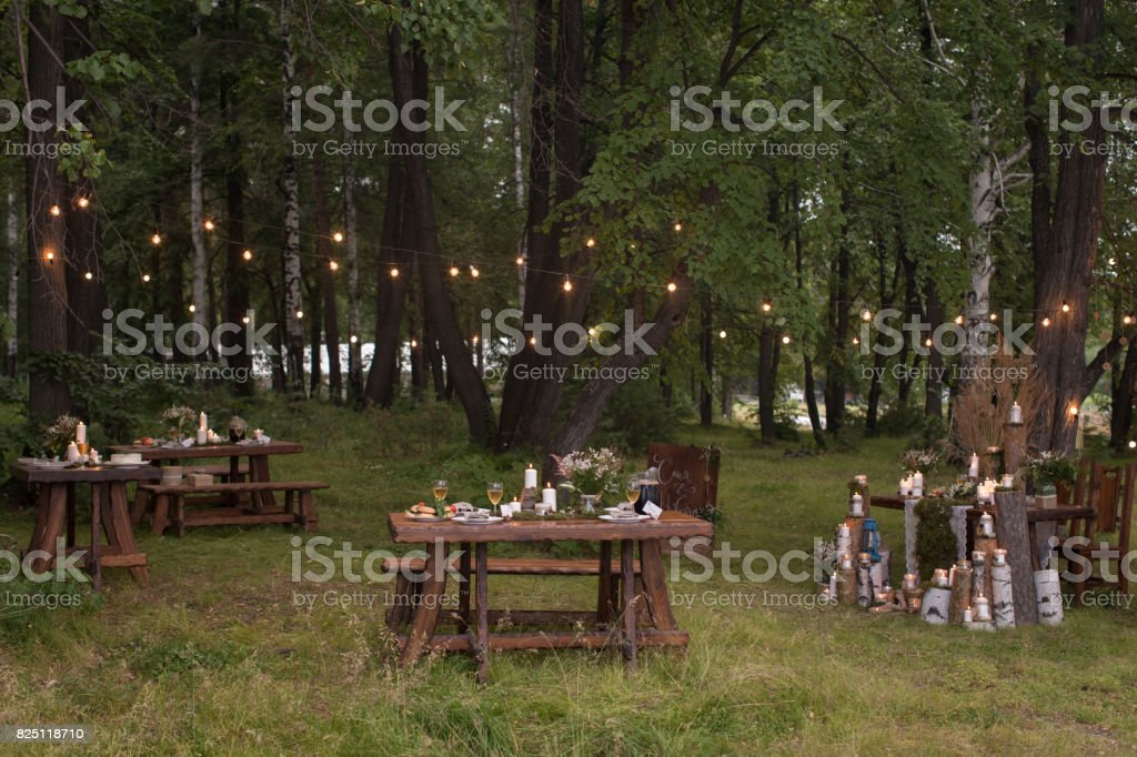 Tables set in forest stock photo
