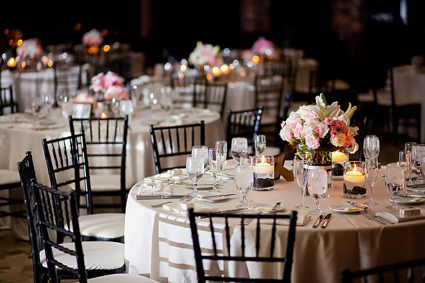 Tables with centerpieces at wedding reception stock photo