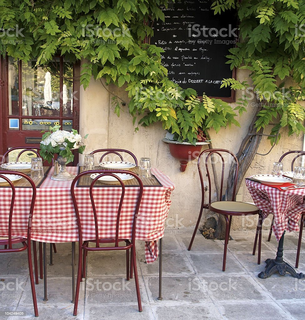 Tables with checkered tablecloths at sidewalk cafe stock photo