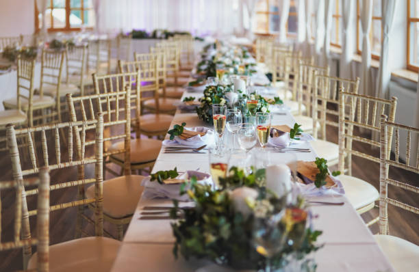 Tables with decoration and plates ready at wedding reception, shallow depth of field photo stock photo