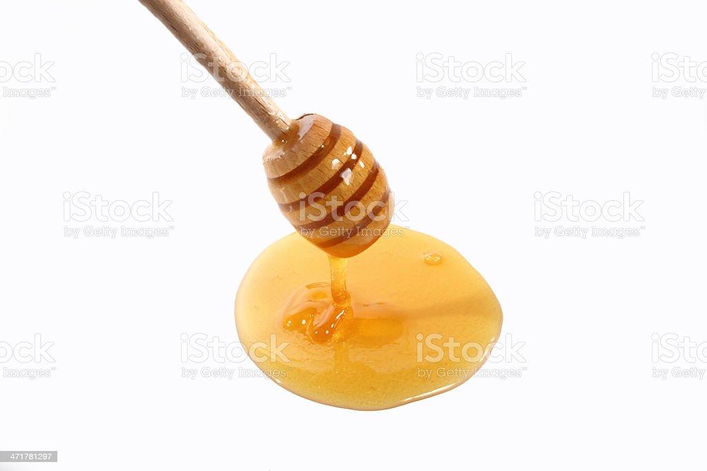 tablespoon honey on white royalty-free stock photo