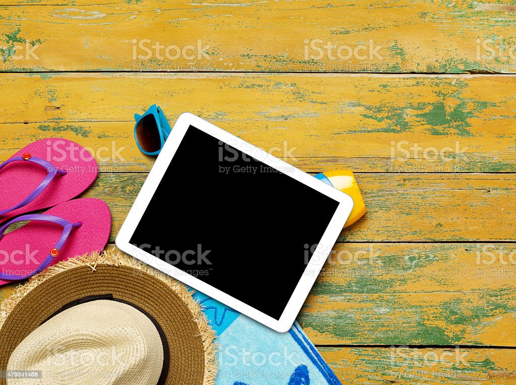 Tablet and beach accessories stock photo