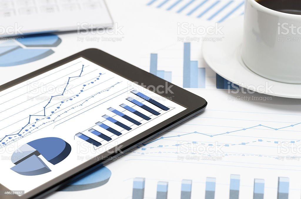 Tablet and business charts (XXXLarge) royalty-free stock photo