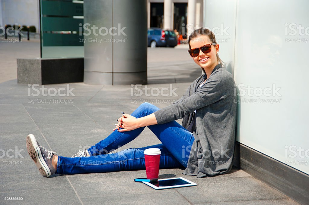 Tablet and cellphone on street with waoman. stock photo