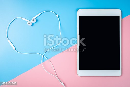 istock Tablet and earphone on pastel background for Mock up 828404242