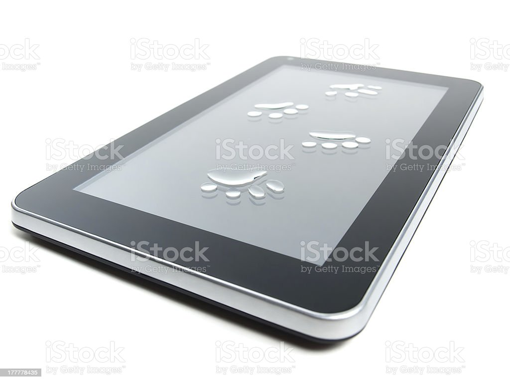 Tablet and paw prints stock photo