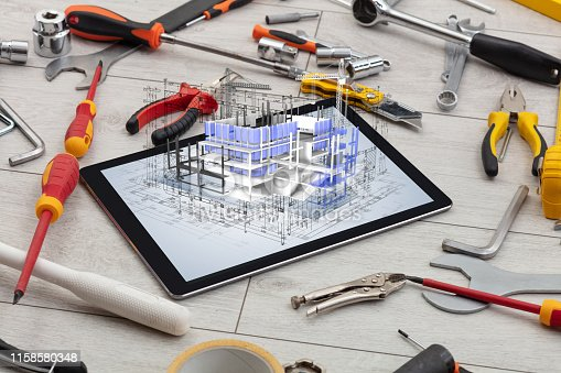 istock Tablet and tools with 3d house plan concept 1158580348