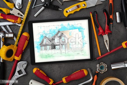 istock Tablet and tools with house plan concept 1158580519