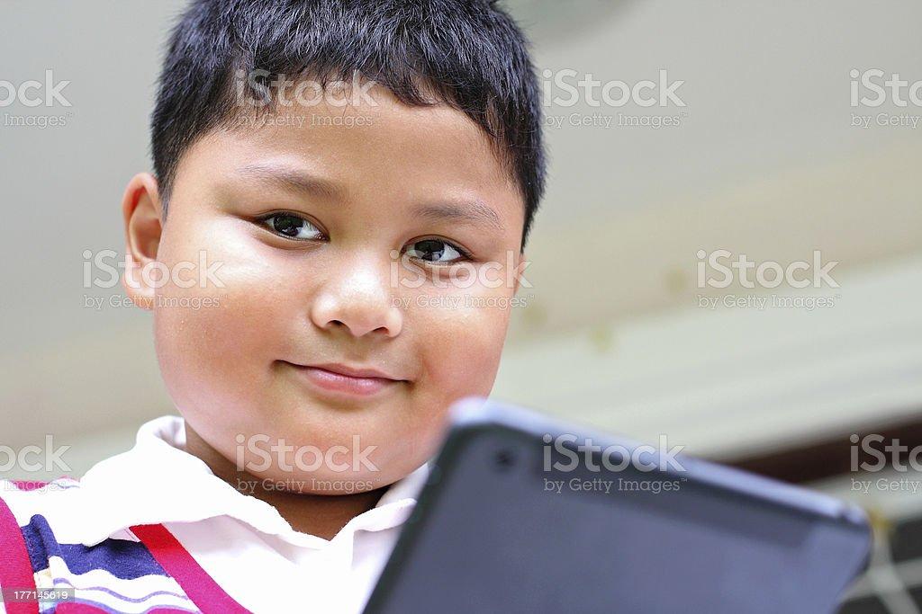 Tablet boy playing fun. royalty-free stock photo