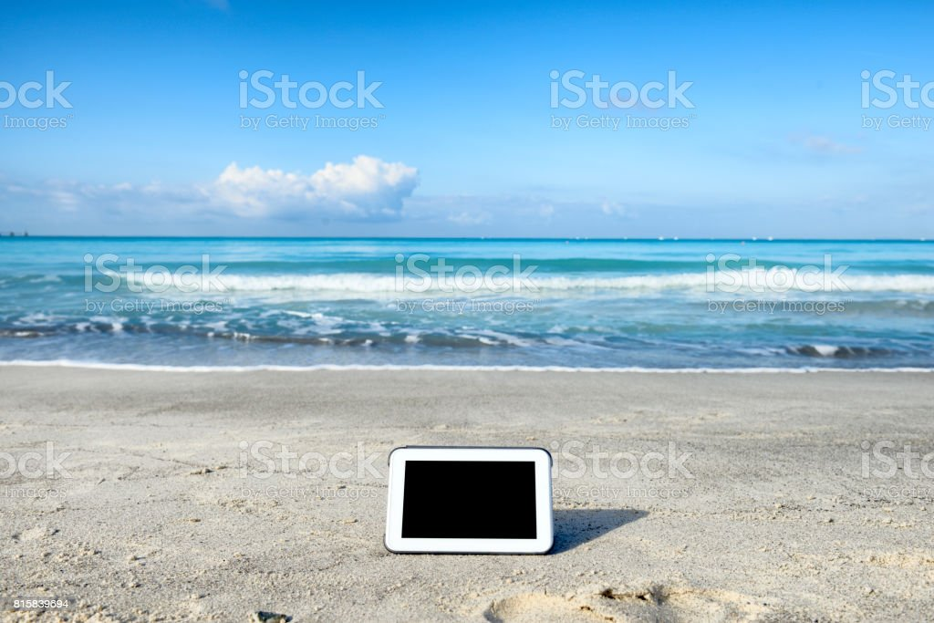 Tablet by the beach stock photo