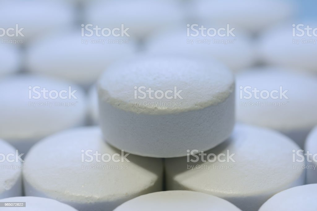 tablet close-up, against the background of other drugs zbiór zdjęć royalty-free