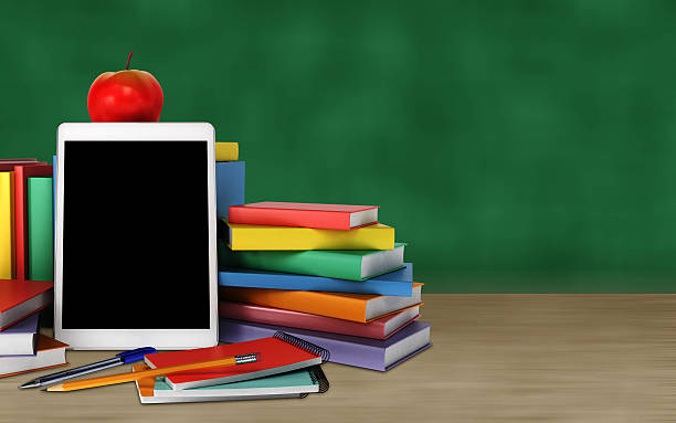 tablet, colorful books, school supplies and apple on the table – Foto