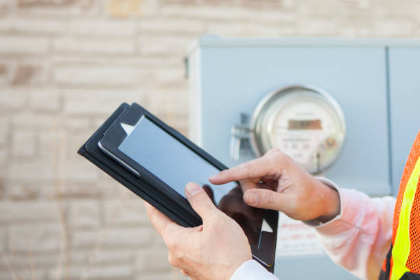 Tablet Computer being used to Collect Electricity Meter Information stock photo